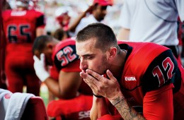 Doughty pauses before taking the field against the Bowling Green State Falcons at Smith Stadium. WKU would go on to win 59-31 with a record-breaking night by Doughty.