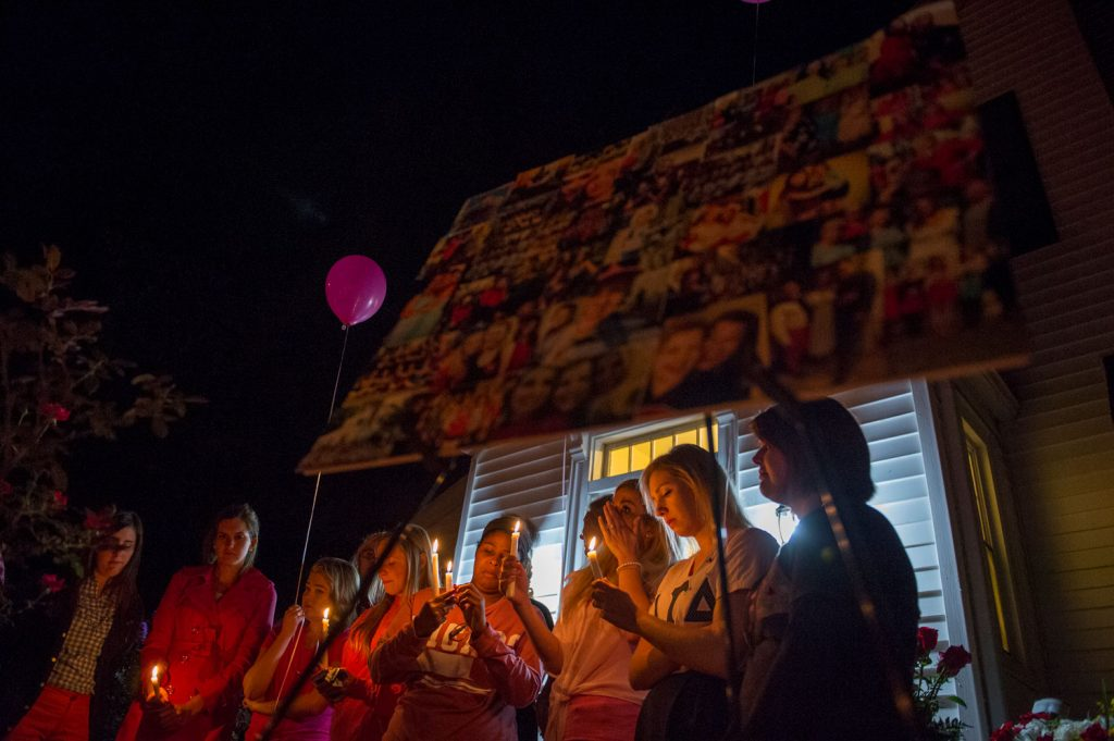 Alpha Gamma Delta alumni shares with hundreds during a vigil honor for Stephanie Campbell in front of the Alpha Gamma Delta house. Campbell died in a single car accident Grayson County. (Talisman/Michael Noble Jr.)