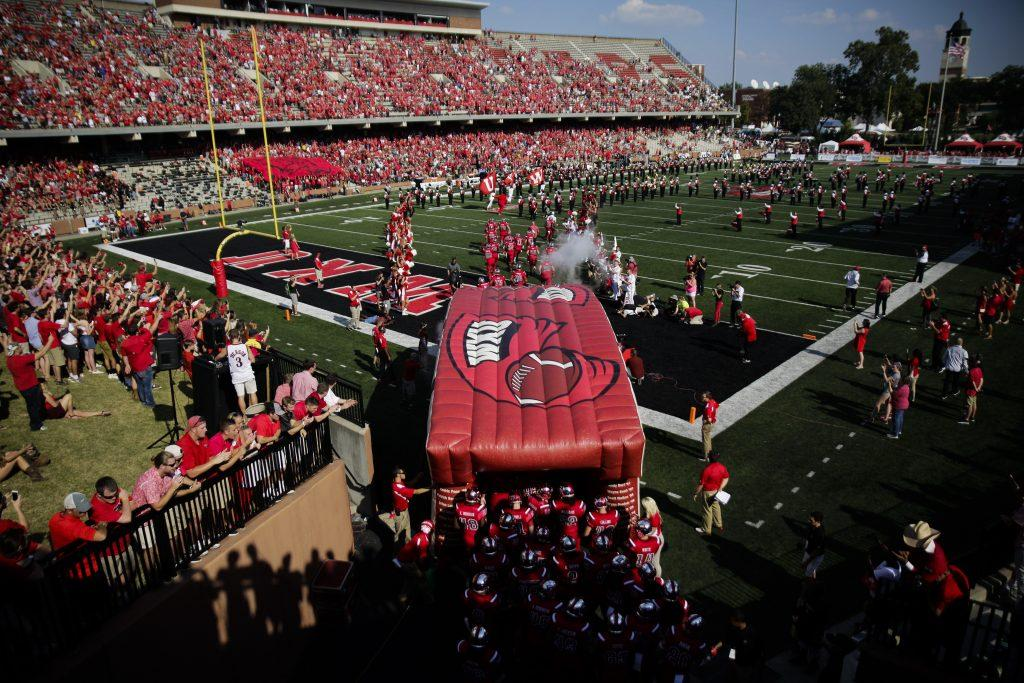 The WKU football team runs through the tunnel onto the field before their game against Vanderbilt on Sept. 24, 2016 at L.T. Smith Stadium.