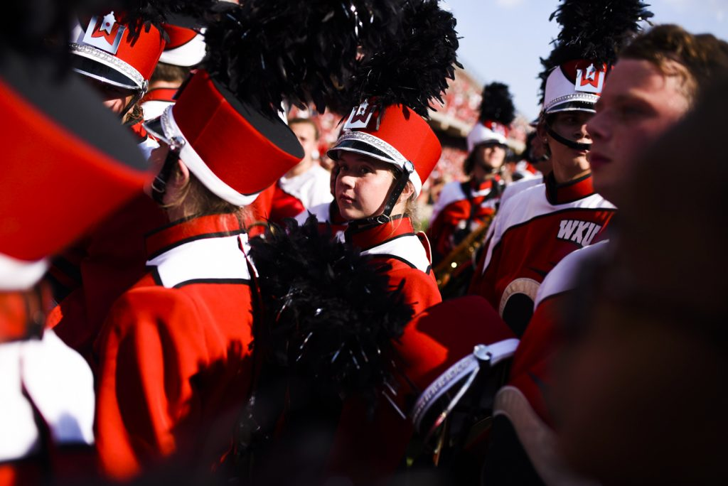 Members of the marching band wait on the sidelines at the LT Houchens-Smith Stadium while Western Kentucky University took on Vanderbilt on Saturday, Sept. 24, 2016.