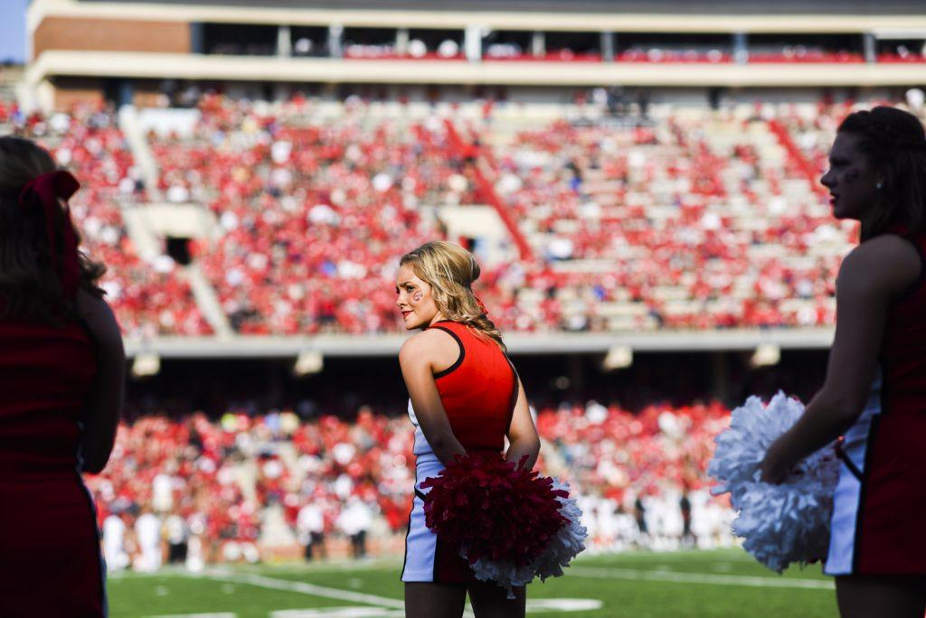 Cheerleaders perform on the sidelines at the LT Houchens-Smith Stadium while Western Kentucky University took on Vanderbilt on Saturday, Sept. 24, 2016.
