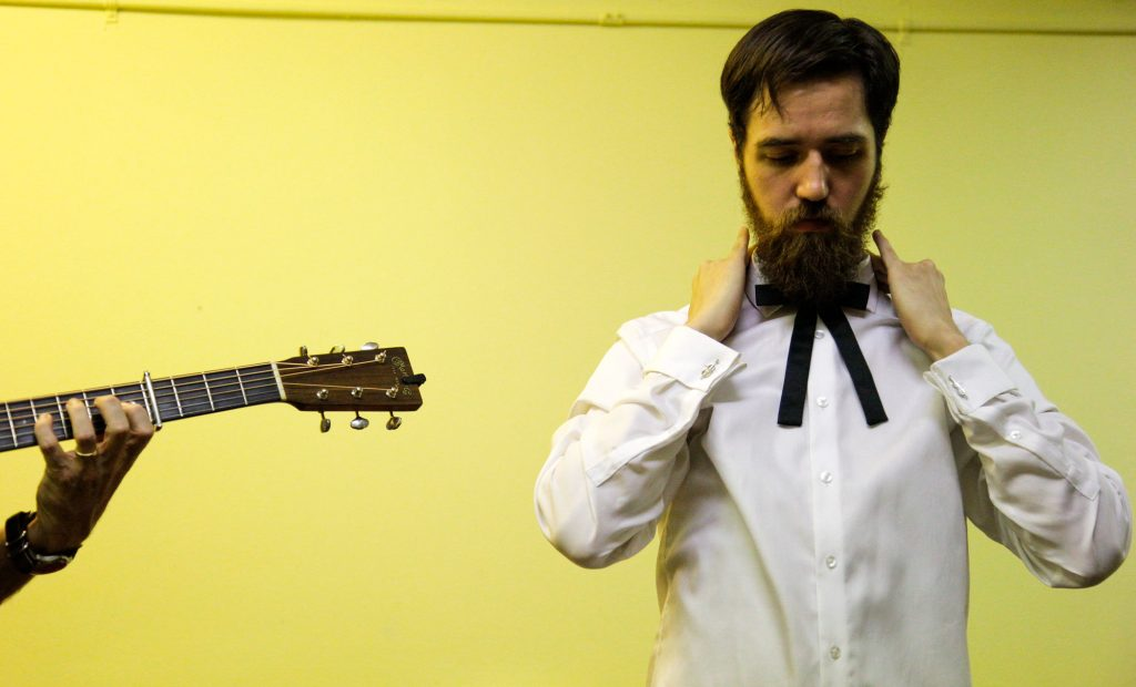 Derek Harris, the bass player for The Misty Mountain String Band, fixes his tie backstage before the start of the first Live Lost River Music Session at the Capitol Arts Center on September 15th, 2016. This Lost River Music Session hosted a variety of folk-genres for a packed crowd, such as Bluegrass and Americana.