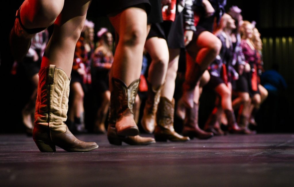 "Kappa Sig members dance in cowboy boots during their ""Let's Make a Band"" routine at Shenanigans, which featured dancing from several genres of music."