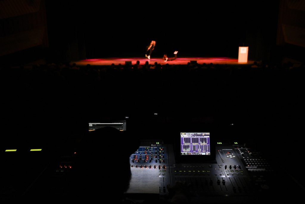 A member of the SKyPAC technical crew runs sound during Shenanigans. Each act consisted of several songs stitched together with lip-synced conversations and skits in between.