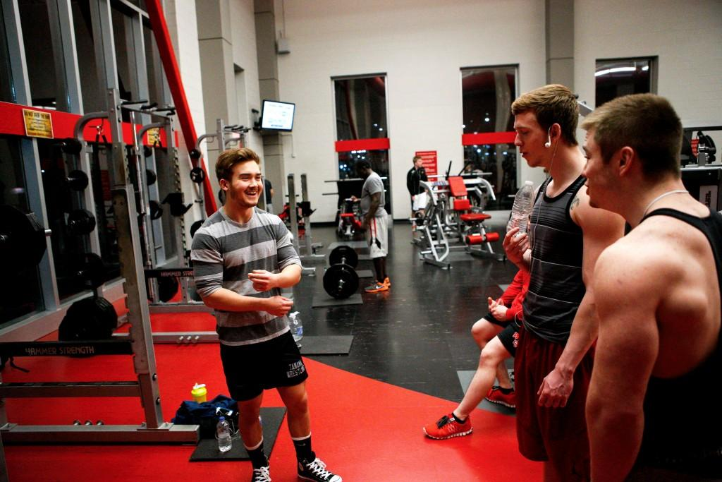 Elizabethtown sophomore Jared Coffell laughs with his friends during his workout at the Preston Center. While training, Coffell became friends with many of the regulars in the gym.