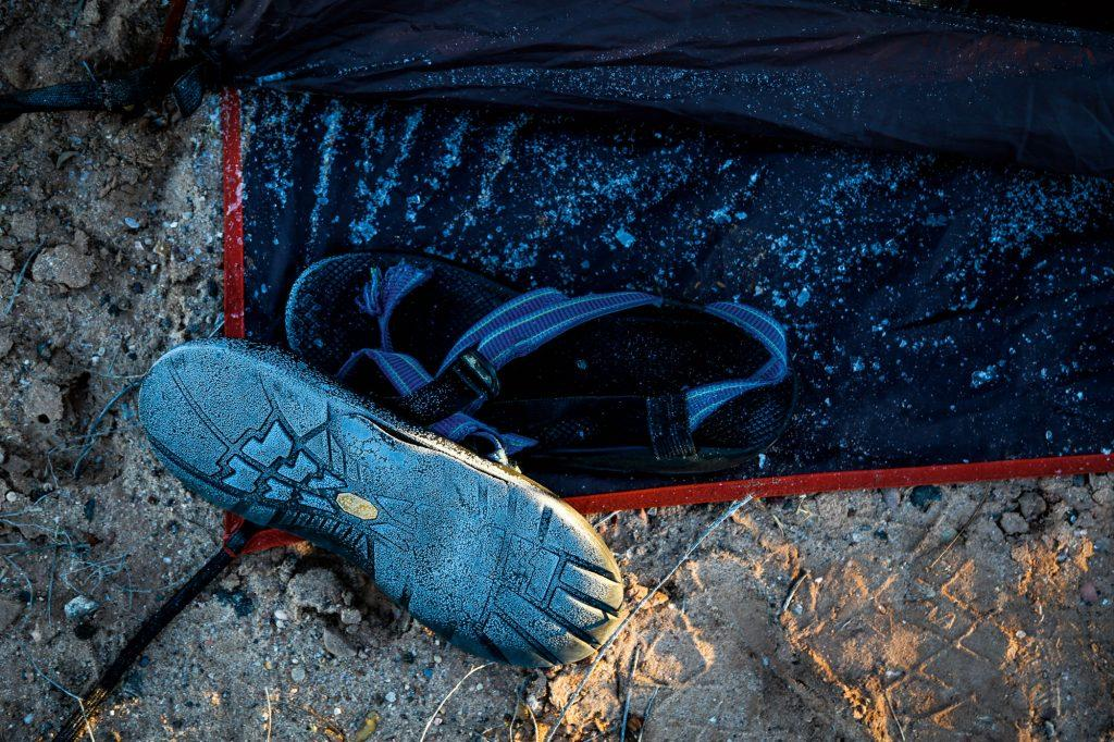 Frozen sandals lay on the ground at Homolovi State Park in Winslow, Arizona, on Nov. 23. The crew woke up at sunrise to a frost-covered desert in order to complete their final hours on the road before reaching Grand Canyon National Park.