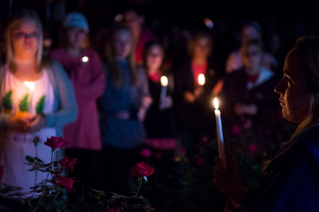 Mourners gather honor for Stephanie Campbell in front of the Alpha Gamma Delta house. Campbell died in a single car accident. (Talisman/Michael Noble Jr.)