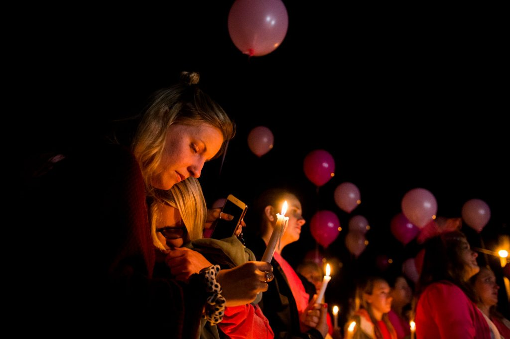Hayley Hogback, from left, Izzy Rager, comfort each other during a vigil for Stephanie Campbell in front of the Alpha Gamma Delta house. Campbell died in a single car accident in Grayson County. (Talisman/Michael Noble Jr.)