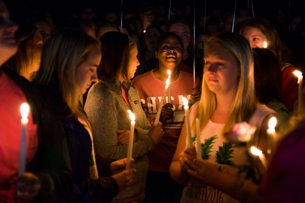 Alpha Gamma Delta alumni Rachel Shipp laughs when remembering Stephanie Campbell with friends and family at a vigil for in front of the Alpha Gamma Delta house. Campbell died in a single car accident. (Talisman/Michael Noble Jr.)
