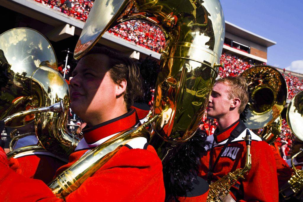 The hot sun beats down on members of the WKU marching band as they file off the sidelines and into the stands as the Hilltoppers take on Vanderbilt.