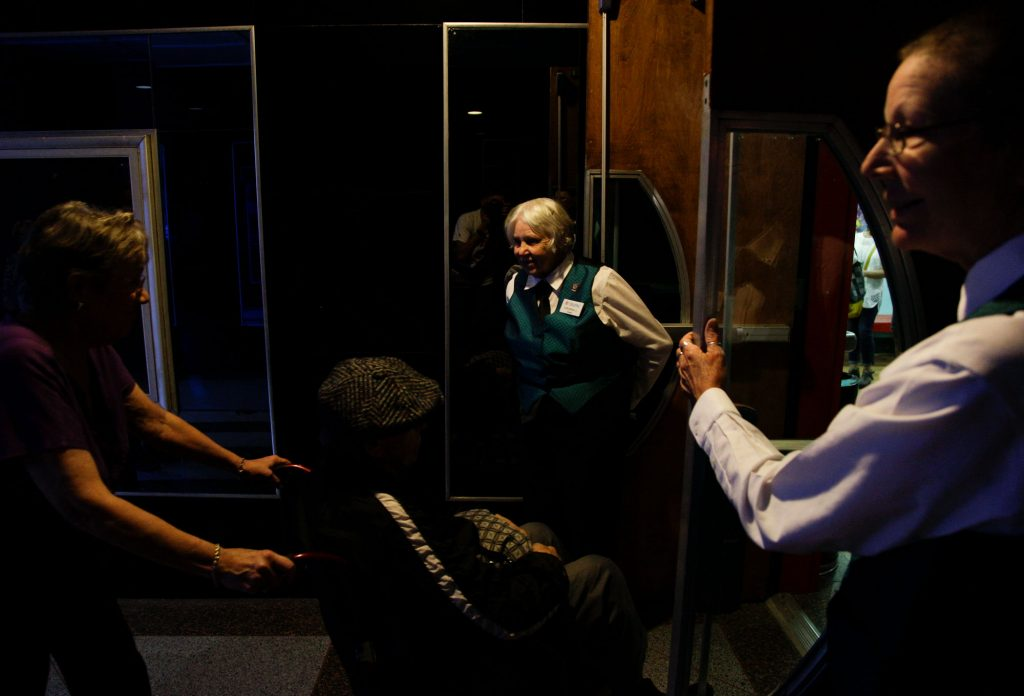 SkyPac volunteer, Virginia Cole, 84, middle, holds the door open for people who attended the first Live Lost River Music Session at the Capitol Arts Center on September 15th, 2016. This Lost River Music Session hosted a variety of folk-genres for a packed crowd, such as Bluegrass and Americana.