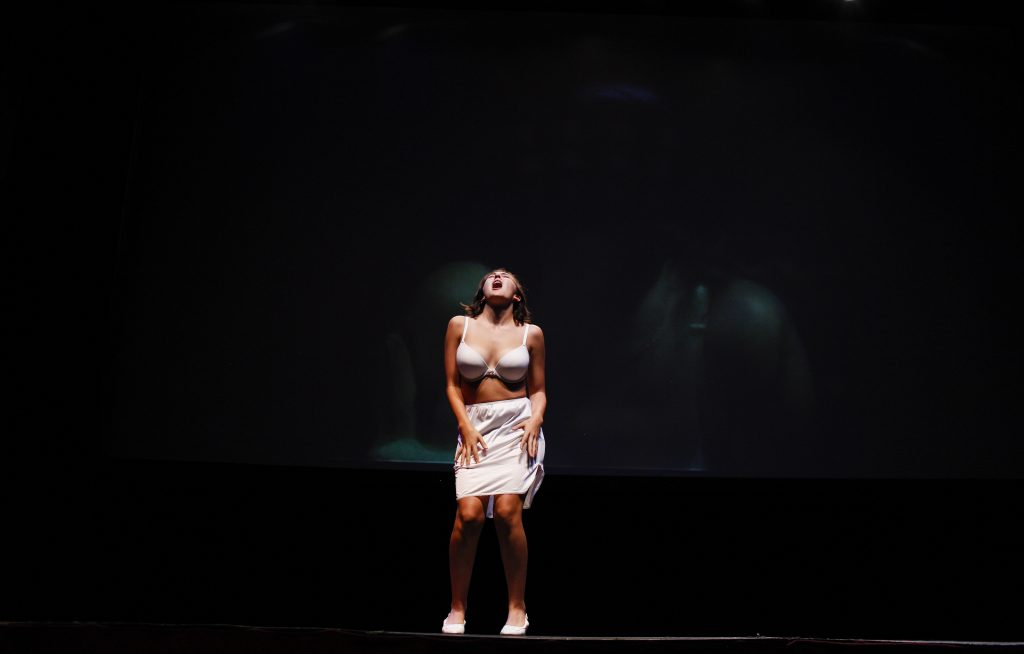 """Nasato acts out the role of Janet during the song """"touch a touch me"""" before the final show. The final performance was held at the Capitol Arts Center in downtown Bowling Green. Photo by Mhari Shaw."""