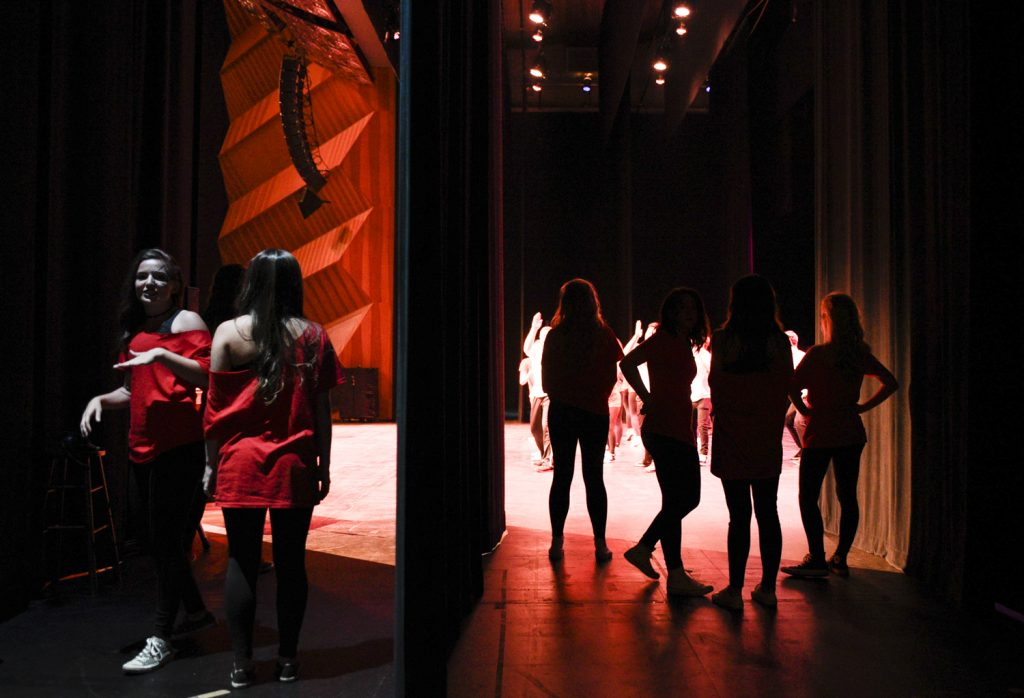 The women of Chi Ostand backstage during their performance. The Sigma Nus and the Chi Os were last to go on stage.